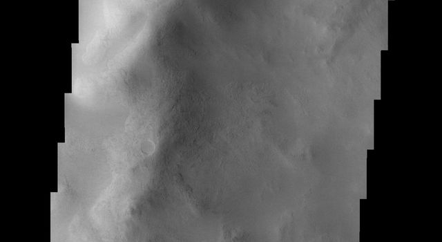 The gullies at the top of the image captured by NASA's 2001 Mars Odyssey spacecraft occur on the rim of an unnamed crater on the larger rim of the Argyre Basin on Mars.