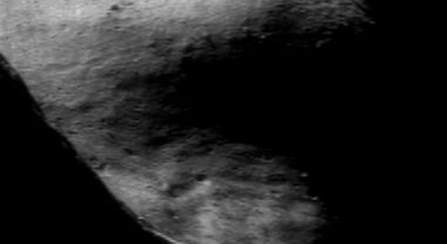 This image of asteroid Eros taken on Nov. 24, 2000, by NASA's NEAR Shoemaker shows the shadowed high terrain east of the saddle.