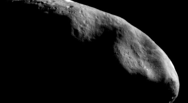 This image of asteroid Eros, taken by NASA's NEAR Shoemaker on Dec. 3, 2000, shows an overview of the eastern part of the asteroid's southern hemisphere. The conspicuous depression just above the center of the frame is the saddle-shaped feature Himeros.
