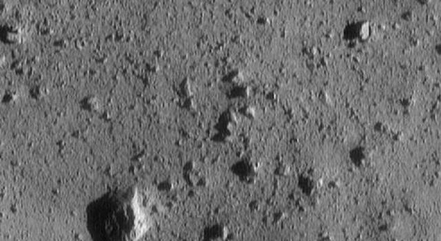 This image of asteroid 433 Eros, taken by NASA's NEAR Shoemaker shows a large rock at lower left on the surface.