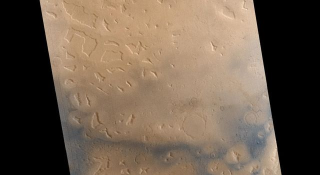 NASA's Mars Global Surveyor shows fretted terrain in mesas and buttes in northern Deuteronilus Mensaeon Mars.
