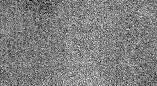 NASA's Mars Global Surveyor shows two circular features on the plains of northern Utopia on Mars. A common sight on the martian northern plains, these rings indicate the locations of buried impact craters.