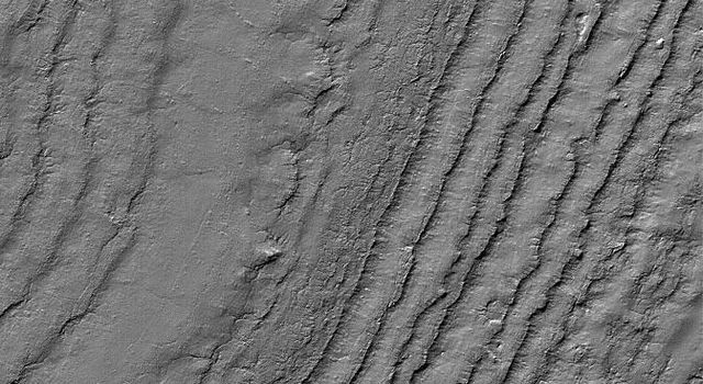 This image from NASA's Mars Global Surveyor shows layered material exposed on a slope in the south polar region of Mars. The composition of the layers, and whether they contain ice, is not known.