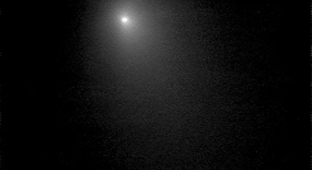 This image of comet Tempel 1 is a compilation of nine images that were taken on June 15, 2005 by NASA's Deep Impact spacecraft. The comet's coma shines brightly.