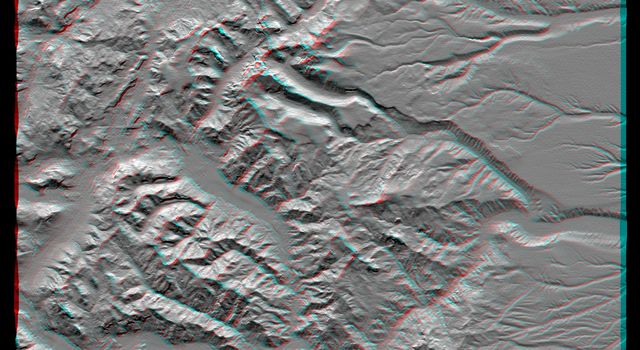 This anaglyph, from the instrument onboard NASA's Shuttle Radar Topography Mission, shows an area south of San Martin de Los Andes, Argentina. 3D glasses are necessary to view this image.