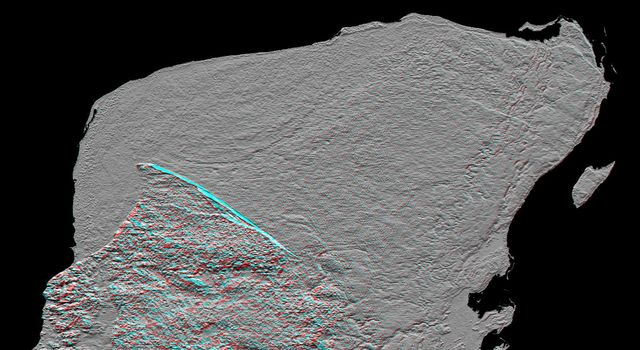 This anaglyph of Mexico's Yucatan Peninsula was generated from NASA's Shuttle Radar Topography Mission data, and shows a subtle but distinctive indication of the Chicxulub impact crater. 3D glasses are necessary to view this image.