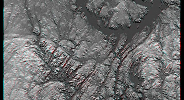 Manicouagan Crater is one of the world's largest and oldest known impact craters and perhaps the one most readily apparent to astronauts in orbit. This anaglyph is from the instrument onboard NASA's Shuttle Radar Topography Mission. 3D glasses needed.