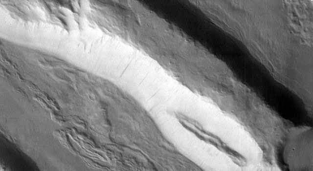 This visible-light image, taken by the thermal emission imaging system's camera on NASA's Mars Odyssey spacecraft, shows the highly fractured, faulted and deformed Acheron Fossae region of Mars.