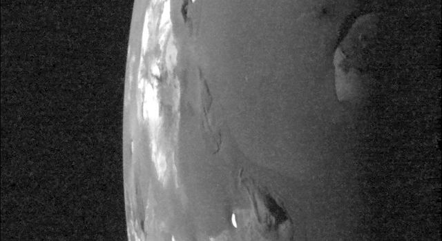 Light from the setting Sun falls across the Loki volcanic region on Jupiter's moon Io in this image taken by NASA's Galileo spacecraft on Oct. 16, 2001. The image was taken to examine the relative depths and heights of features in the region.