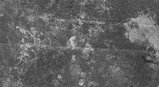Fluids have flowed and cut these deeply-incised channels into the icy surface of Titan as seen in this Synthetic Aperture Radar image obtained by NASA's Cassini spacecraft.