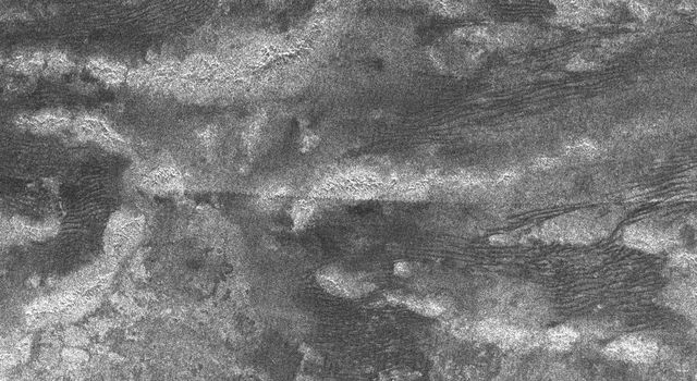 This synthetic aperture radar image of Titan was taken on Oct. 28, 2005, as NASA's Cassini spacecraft flew by at a distance of 1,350 kilometers (840 miles).