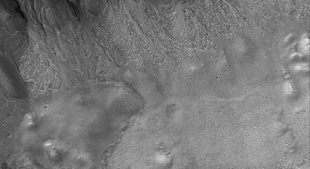 NASA's Mars Global Surveyor shows a suite of south mid-latitude gullies on a crater wall on Mars. Gullies such as these may have formed by runoff of liquid water.