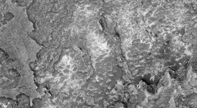 NASA's Mars Global Surveyor shows eroded sedimentary rock outcrops in northern Sinus Meridiani on Mars.