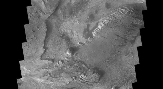 The layered and wind eroded deposits occur on the floor of Chandor Chasma on Mars as seen by NASA's 2001 Mars Odyssey spacecraft.