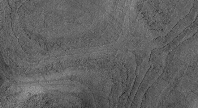NASA's Mars Global Surveyor shows a banded surface in Argyre Planitia, the second largest impact basin in the martian southern hemisphere. The bands are the erosional expression of layered, perhaps sedimentary, rock.