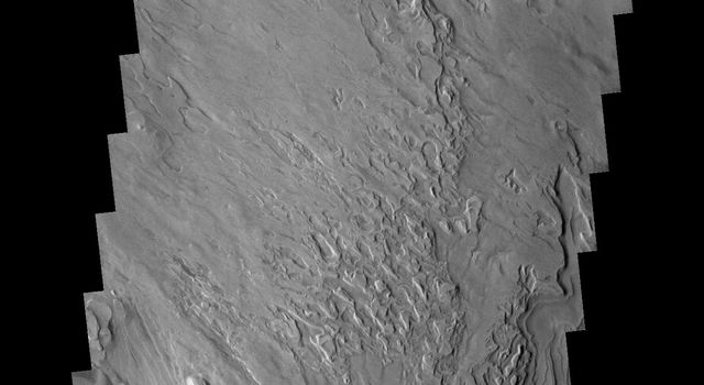 Taken by NASA's 2001 Mars Odyssey these are the unusual floor deposits in Spallanzani Crater. The wind may have affected the surface of the layered deposit. Small dunes have formed near the southern margin.