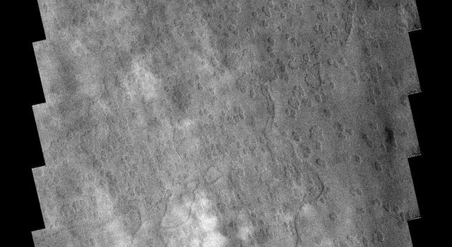 These clouds are located near the edge of the south polar region on Mars . The cloud tops are the puffy white features in the bottom half of the image as seen by NASA's 2001 Mars Odyssey spacecraft.