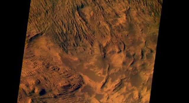 This image from NASA's Mars Odyssey was acquired of Candor Chasma within Valles Marineris and shows the effects of erosion on a sequence of dramatically layered rocks.