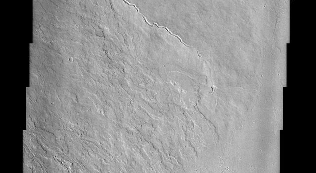 Olympus Mons, imaged here by NASA's Mars Odyssey spacecraft, stands 26 km above the surrounding plains, which is three times taller than Mt. Everest, and is the tallest volcano in the solar system.