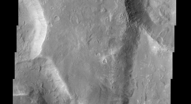 This image from NASA's Mars Odyssey spacecraft captures two channels (Nirgal Vallis is the smaller sinuous channel on the left and Uzboi Vallis is the larger channel located in the lower right) and Luki Crater located in the upper right.