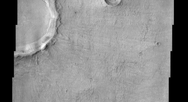 Bosporus Planum, seen in this image from NASA's Mars Odyssey spacecraft, is located in a region of smooth plains that appear to have formed from lava flows.