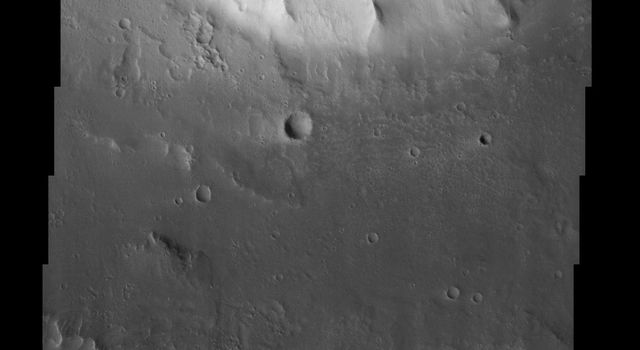 Kasei Valles is one of the largest outflow channels on Mars. This NASA Mars Odyssey image is of the northern branch of Kasei Valles and shows the channel floor and northern channel wall.