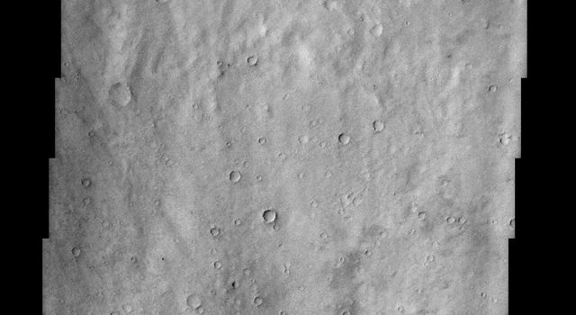 This NASA Mars Odyssey image shows a close-up view of the ridged plains in Hesperia Planum, a classic locality for Martian surfaces that formed in the 'middle ages' of the planet's history.