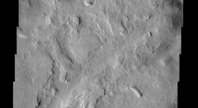 A portion of an ancient channel called the Huo Hsing Vallis is seen in the center of this image from NASA's Mars Odyssey. As with all channel forms on Mars, it was carved by some moving fluid but that fluid can not automatically be assumed to be water.