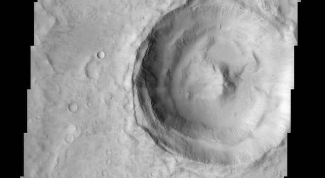 This image taken by NASA's Mars Odyssey spacecraft shows a classic example of a Martian impact crater with a central peak. Central peaks are common in large, fresh craters on both Mars and the Moon.
