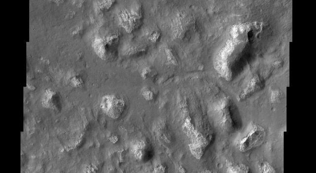 Among the many varied landscapes on Mars the term chaos is applied to those places that have a jumbled, blocky appearance, like in this image from NASA Mars Odyssey spacecraft.