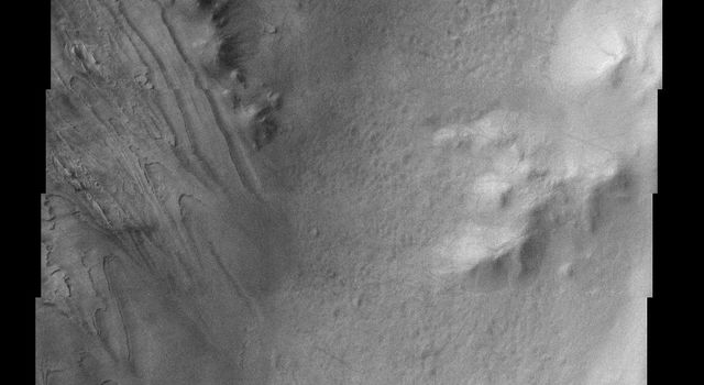 This image from NASA's Mars Odyssey spacecraft shows part of Galle Crater. It was taken far enough south and late enough into the southern hemisphere fall to observe water ice clouds partially obscuring the surface.