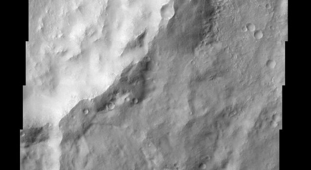 The eastern rim of this unnamed crater in Claritas Fossae is very degraded, as seen in this image from NASA's Mars Odyssey, indicating that it's very ancient and has been subjected to erosion and bombardment from impactors such as asteroids and comets.