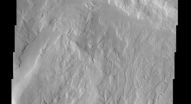 This image from NASA's Mars Odyssey shows a region of Mars' northern hemisphere called Ismenia Fossae. Most of the landforms are the degraded remains of impact crater rim and ejecta from an unnamed crater (75 km diameter) just north of this scene.