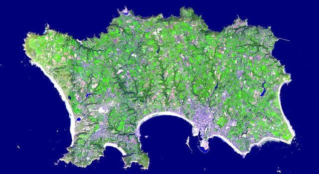 The Isle of Jersey (officially called the Bailiwick of Jersey) is the largest Channel Island, positioned in the Bay of Mont St Michel off the north-west coast of France. This image was acquired by NASA's Terra satellite on September 23, 2000.