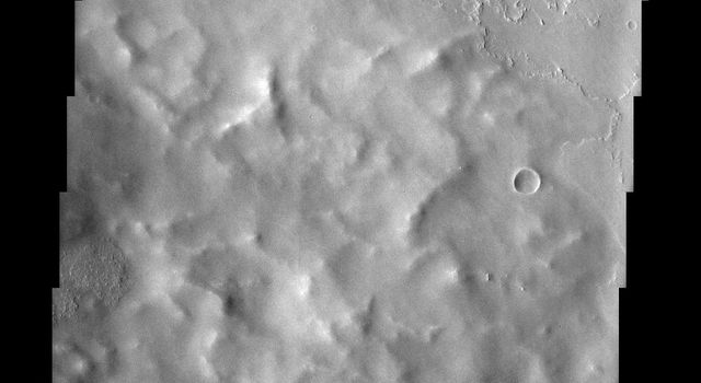 Located roughly equidistant between two massive volcanoes, the approximately 60 km Poynting Crater and its ejecta, shown in this image from NASA's Mars Odyssey spacecraft, have experienced an onslaught of volcanic activity.