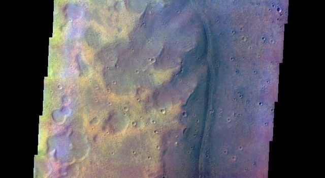 This false color image from NASA's Mars Odyssey spacecraft shows craters and a channel margin, in the region of southern Acidalia Planitia where Tiu and Ares Valles empty into the planitia. This image was collected during the northern spring season.