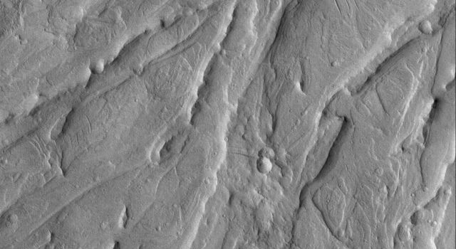 NASA's Mars Global Surveyor shows a complex of overlapping, inverted channels in a fan exposed by erosion, then mantled by dust, in the Aeolis region of Mars.
