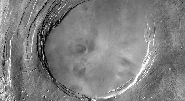 This image from NASA's Mars Odyssey spacecraft shows Arsia Mons, the southernmost of the Tharsis volcanoes. For comparison, the largest volcano on Earth is Mauna Loa.