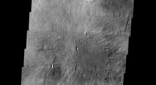 This image from NASA's Mars Odyssey spacecraft shows part of the summit calera of Arsia Mons. There are numerous small volcanic constructs with lava flows in the image.