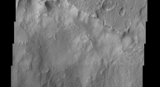 Except for the loss of its ring of ejecta, the crater at the leading edge of this streamlined island in Kasei Vallis, imaged here by NASA's Mars Odyssey, shows no hint of the catastrophic floods that passed by it.