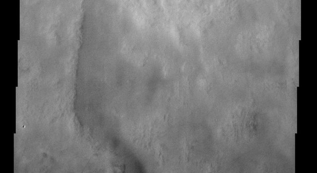 This image from NASA's Mars Odyssey spacecraft shows Rampart crater in Utopia Planitia, west of NASA's Viking 2 landing site.