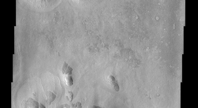 An isolated mesa east of the Phlegra Montes in northeastern Elysium Planitia has a cracked surface that, combined with its overall shape, gives the appearance of a giant loaf of bread in this image from NASA's Mars Odyssey spacecraft.