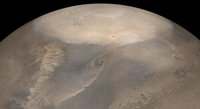 NASA's Mars Global Surveyor shows dust storms on Mars observed during the northern spring in May 2002. The north polar cap is the bright, frosty surface at the top.