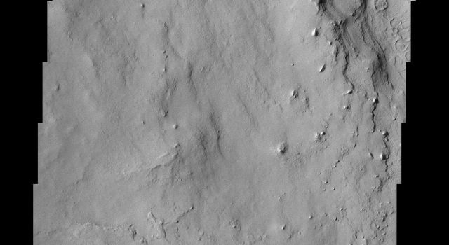 Located in Arabia Terra, the crater shown in this image from NASA's Mars Odyssey spacecraft is known as Henry Crater. Like many other craters on Mars, the interior of Henry Crater is filled with a layered deposit.