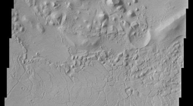 This NASA Mars Odyssey image shows parts of the dissected and eroded remnants of an impact crater rim and volcanic material located north of Apollinaris Patera near the southern highlands - northern lowlands dichotomy on Mars.