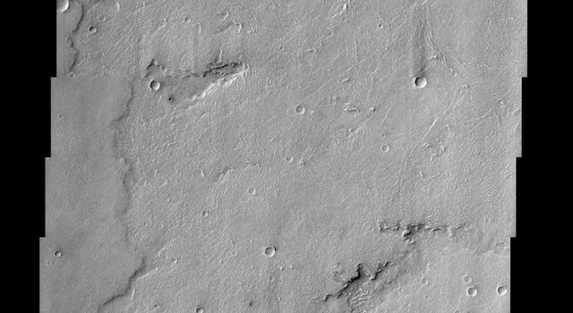 This NASA Mars Odyssey image captures a portion of several lava flows in Daedalia Planum southwest of the Arsia Mons shield volcano. Textures characteristic of the variable surface roughness associated with different lava flows in this region are easily s