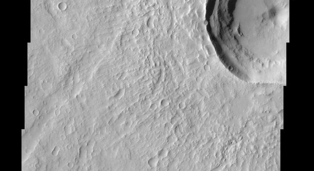 This area of Mars imaged by NASA's Mars Odyssey shows a wonderful example of relative geologic dating. Ancient lava flows and escarpments are mantled by younger impact ejecta, which was cut by a younger graben and resurfaced by smaller impact craters.