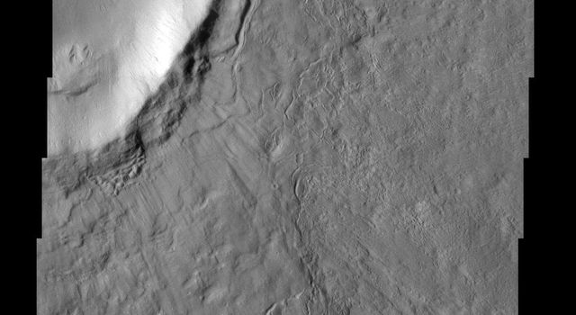 The ejecta of the impact crater shown in this image from NASA's Mars Odyssey spacecraft appears to have been modified after it was emplaced. This modification may be due to the presence of subsurface ground ice.
