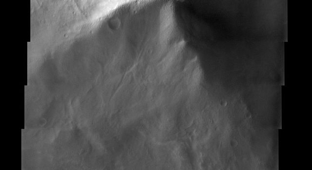 This image from NASA's Mars Odyssey spacecraft shows old, heavily cratered volcanic terrain in Terra Tyrrhena within the Martian southern highlands.