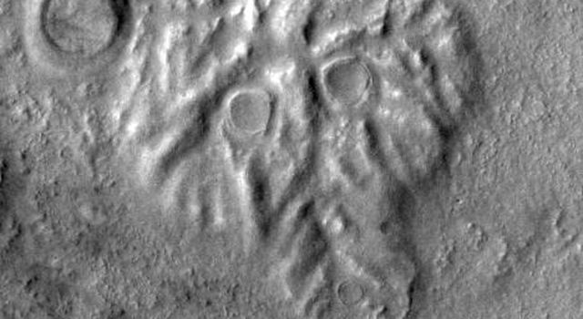 NASA's Mars Odyssey spacecraft takes a look at THEMIS image as art. Many science-fiction writers have postulated many life forms on Mars. A spooky skull stares out of the Martian plain.
